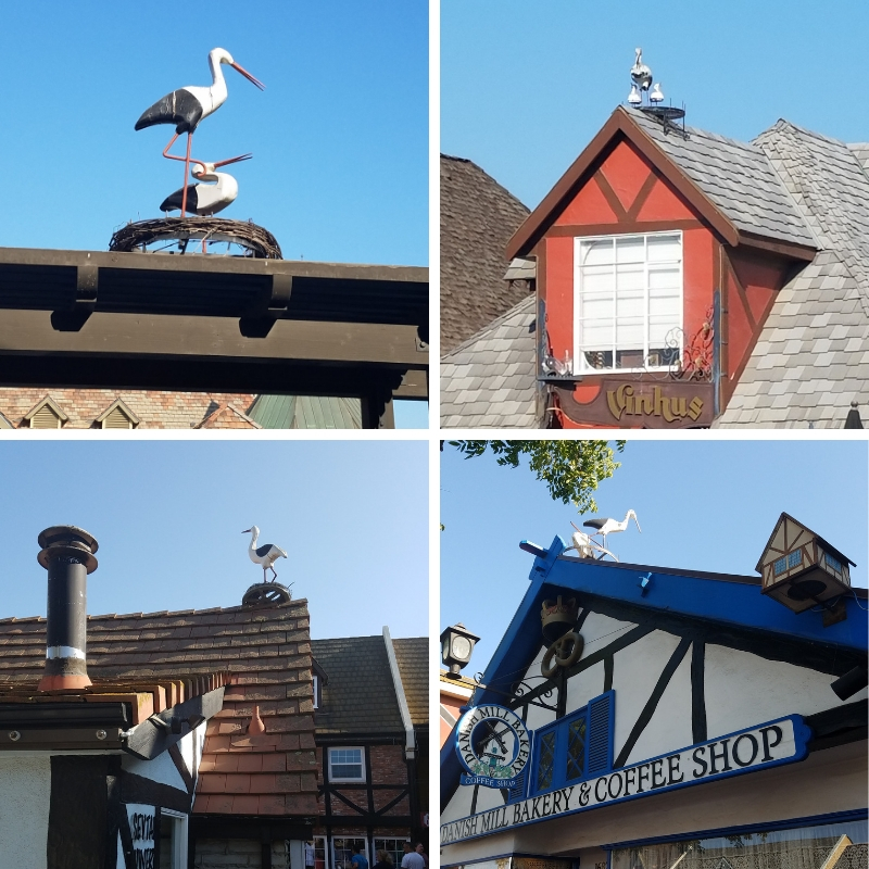 Various stork statues on the rooftops in Solvang California
