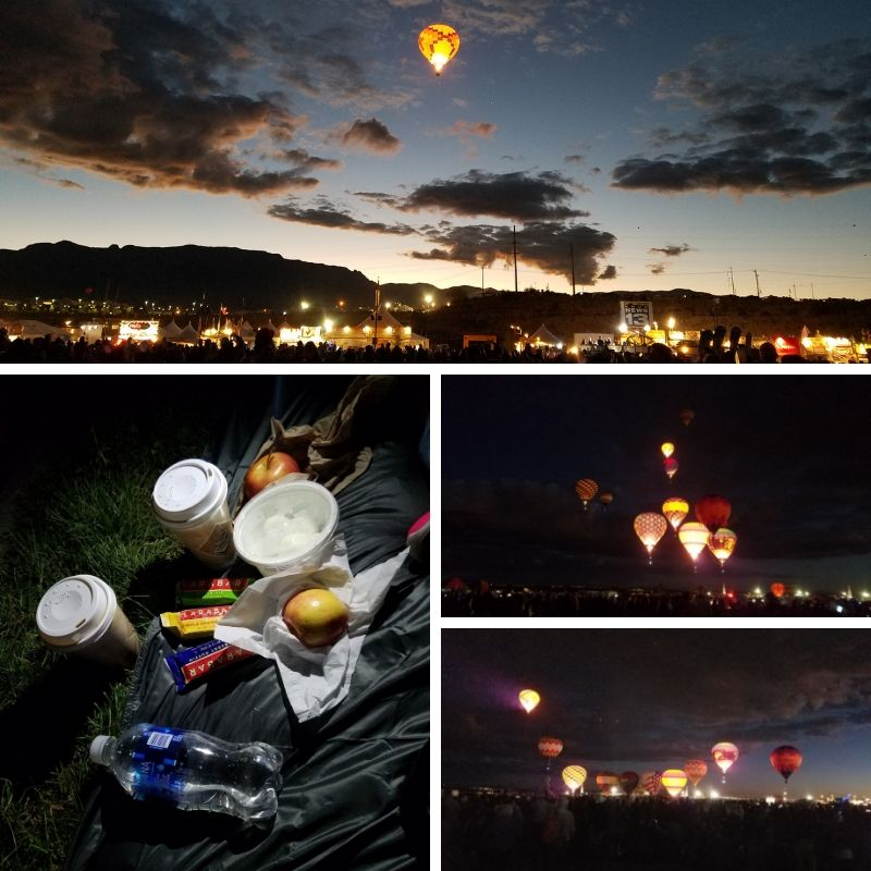 Breakfast picnic of coffee, yogurt and fruit; glowing hot air balloons light up the dark night sky