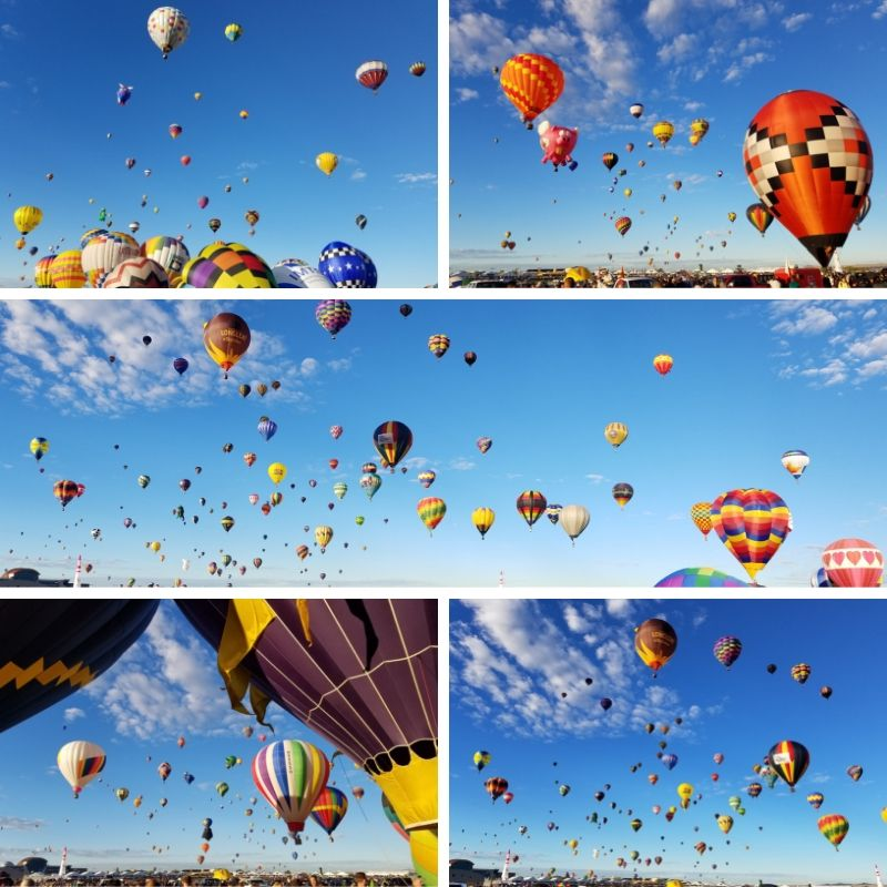 A multitude of hot air balloons fill the sky!
