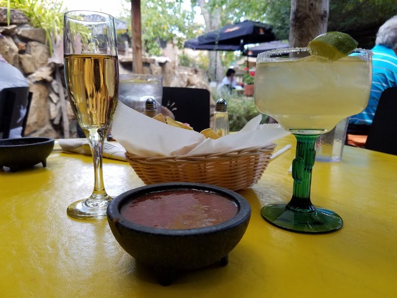 A bowl of chips and salsa with a flute of proscecco and a margarita at the Church Street Cafe in Albuquerque NM