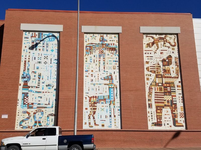 Tryptich mural in Albuquerque in old mosaic style of cave drawings