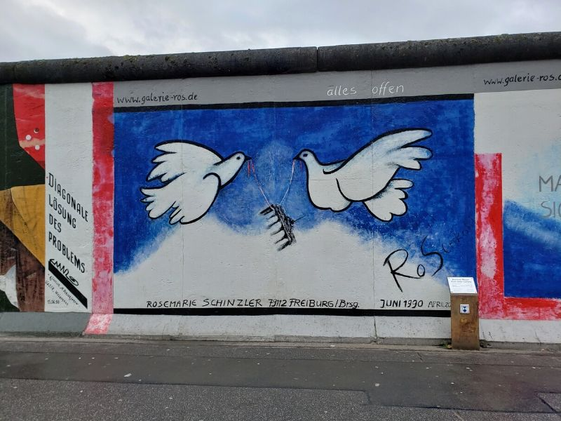 Mural of Doves by Rosemarie Schinzler at the Berlin East Side Gallery